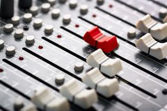 Sound mixer. Red fader ahead Royalty Free Stock Images