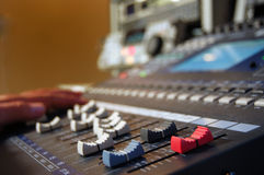 Sound mixer. A modern sound mixer in a studio, focus on faders Royalty Free Stock Images