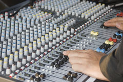 Sound mixer. Close up of a sound mixer being operated.  The machine has been checked for brand names and logo and have been removed Royalty Free Stock Image