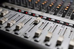Sound mixer, audio mixing console. Close-up on the mixer, knobs, knobs, potentiometers, level knobs, audio mixing console royalty free stock photos