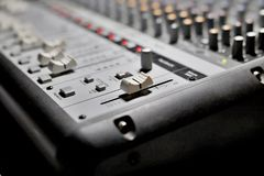 Sound mixer, audio mixing console. Close-up on the mixer, knobs, knobs, potentiometers, level knobs, audio mixing console royalty free stock photo