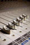 Sound mixer board faders. Sound board fader controllers for managing the volume of music for music production royalty free stock photos