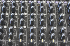Sound Mixer Choices. Close up of knobs/buttons on a sound mixer. The machine has been checked for brand names and logo and have been removed stock image