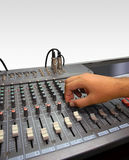 Sound mixer console and hand on white Royalty Free Stock Photography