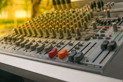 Sound mixer control. Board with volume buttons. , process in soft orange sun light style Royalty Free Stock Images