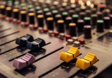 Sound mixer control panel, audio controls. Close-up Stock Photos