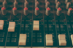 Sound mixer control panel. Close-up of audio controls stock photo