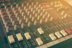 Sound mixer control panel. Close-up of audio controls stock photography