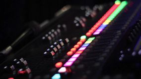 Sound mixer control panel. focus transference. close-up stock footage