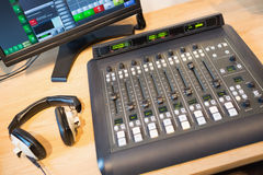 Sound mixer at desk in radio station Royalty Free Stock Images
