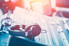 Sound Mixer with headphone musical mixing engineer Stock Photos