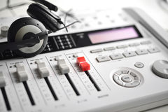 Sound mixer with hi-fi sound guard headphones Stock Photography