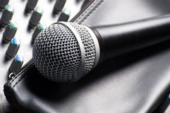 Sound mixer with a microphone. Part of an audio sound mixer with a microphone and its sleeve royalty free stock photos