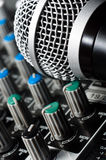 Sound mixer with microphone. And blurs royalty free stock photography