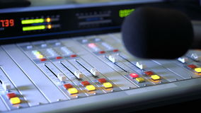 Sound mixer and microphone in the broadcasting studio on radio stock video footage