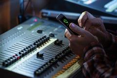 Sound Mixer Operator Call. Sound Mixer Operator Incoming Phone Call. Audio Mixing Job Royalty Free Stock Photo