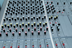 Sound mixer panel. Knobs and switched on old electronic sound mixing control panel Stock Photo