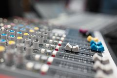 Sound mixer in radio broadcasting and music recording studio. Sound mixer in professional radio broadcasting and music recording studio royalty free stock photo
