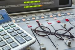 Sound Mixer and Calculator. Sound Mixer in Radio Studio and Calculator Royalty Free Stock Photos