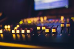 Sound mixer remote sound director. DJ console. music producer. audio equalizer. sound accompaniment. Sound mixer remote sound director. DJ console. music stock image