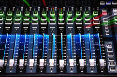 Sound Mixer System with Explosion Light. Main Board of Sound Mixer System with Operating Light by Zoom Burst Lighting Royalty Free Stock Images