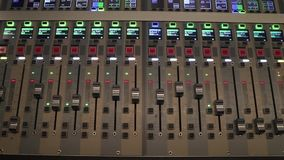 Digital sound board used to mix audio. Sound mixer used for mixing audio and music for live events, concerts, festivals, broadcast television, radio stock video