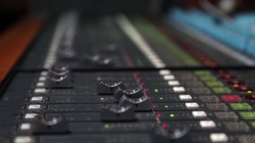 Digital sound board used to mix audio. Sound mixer used for mixing audio and music for live events, concerts, festivals, broadcast television, radio with faders stock video footage