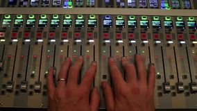 Hand operating Digital sound board used to mix audio. Sound mixer used for mixing audio and music for live events, concerts, festivals, broadcast television stock footage