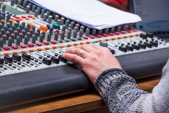 Sound  mixing and amplifying equipment in  studio. Operator regu. Lates  sound power Stock Image