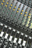 Sound Mixing Board. A sound mixing board showing all the adjustment controls Stock Photo