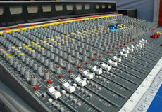 Sound mixing console. Audio mixing console in a recording studio. Faders and knobs of a sound mixer Royalty Free Stock Photos