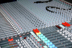 Sound mixing console. Audio mixing console in a recording studio. Faders and knobs of a sound mixer Stock Image