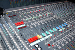 Sound mixing console. Audio mixing console in a recording studio. Faders and knobs of a sound mixer Royalty Free Stock Photo