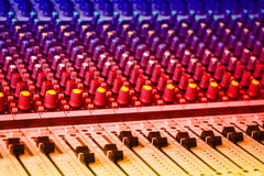 Sound mixing console. With colorful backlit buttons Stock Photos