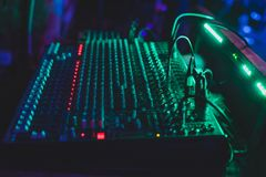 Sound mixing console in a nightclub. Dark soft blurry photo Royalty Free Stock Photo