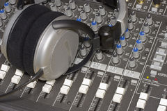 Sound mixing panel. With headphones Royalty Free Stock Photo