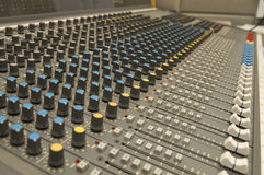 Sound and Music Mixer. A close up of a sound and music mixer in the studio Stock Photos
