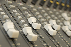 Sound and Music Mixer. A close up of a sound and music mixer in the studio Stock Image