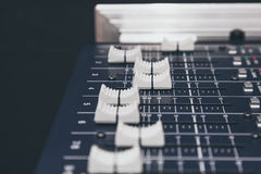 Sound Music mixer control Buttons equipment close up Stock Photography