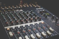 Sound operator console or sound mixer control panel of DJ for music mixing and recording on studio or party. Toned Royalty Free Stock Photos