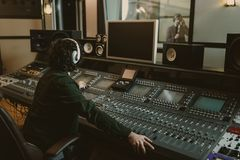 sound producer working at studio while stock photo
