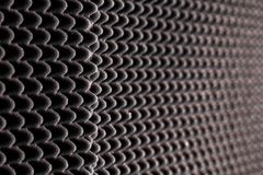 Sound-proofing in the wall at the studio. Black and white, high contrast, repeating elements royalty free stock photography