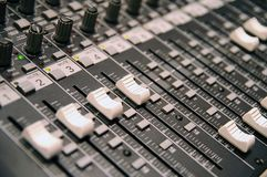 Sound-recording control desk. With sliders and knobs, close up, blur, shallow depth Stock Images