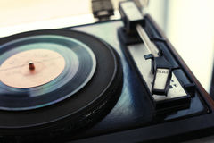 Sound recording and reproduction - Vintage player of vinyl records. Sound recording and reproduction - The vintage player of vinyl records with a retro toning royalty free stock images