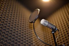 Sound recording room with noise insulation. Microphone with pop filter stock images