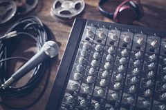 Sound recording studio mixer desk with microphone Royalty Free Stock Images