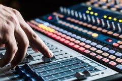 Sound recording studio mixer desk: professional music production. Professional music production in a sound recording studio, mixer desk mixing audio club dj stock image
