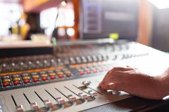 Male hand on control Fader on console. Sound recording studio mixing desk with engineer or music producer. Sound recording studio mixing desk with engineer or royalty free stock photography