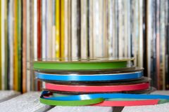 Sound recording tapes and vinyl records. Collection that creates a background Royalty Free Stock Photography