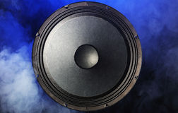 A sound speaker surrounded by blue smoke Stock Photo